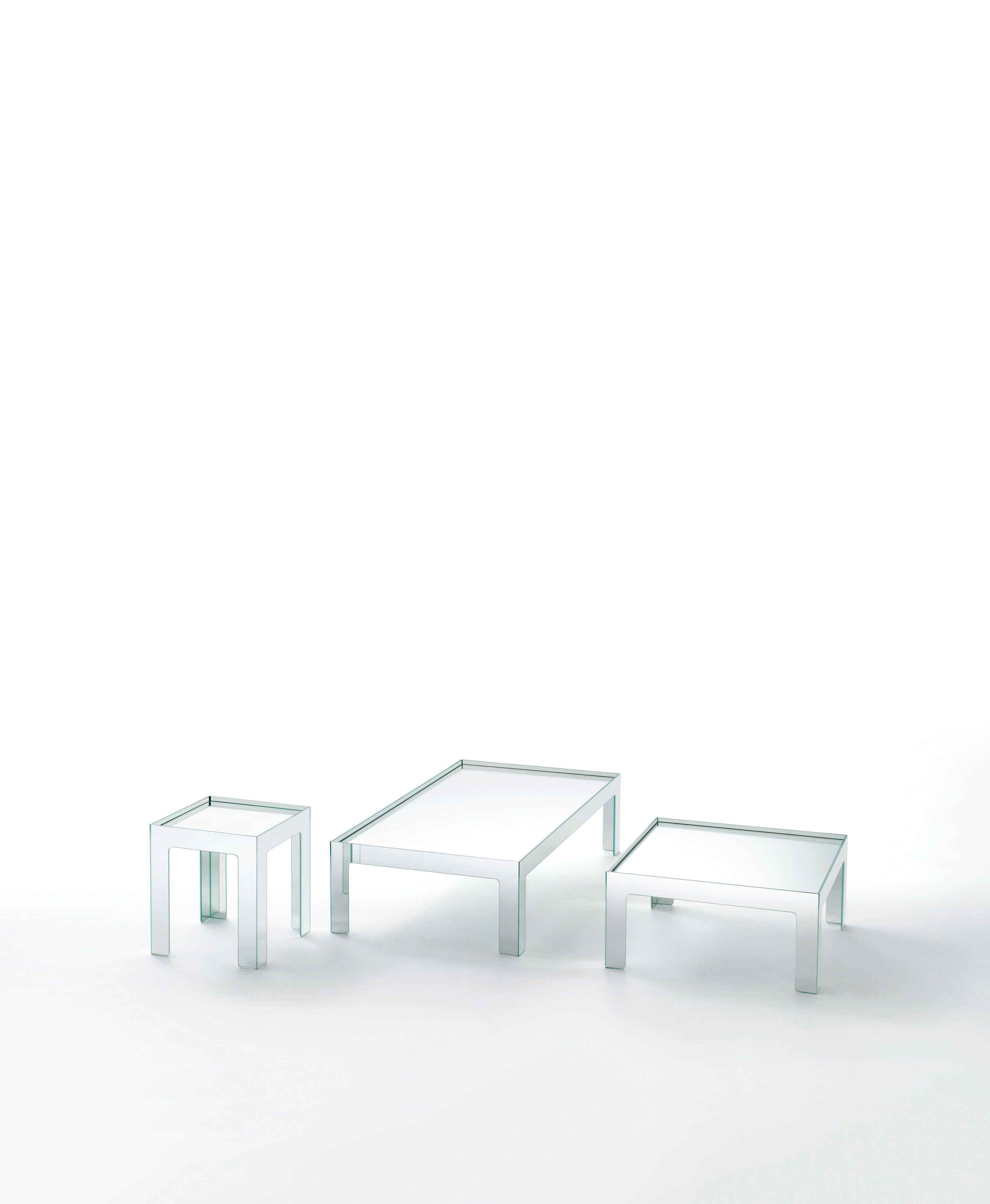 MIRROR MIRROR design Jasper Morrison   Low tables available in different sizes, whose base is obtained by gluing 45° water jet cut laminated double faced mirror slabs. The mirror top rests lower down within the base frame, so as to be contained by an upstand profile.
