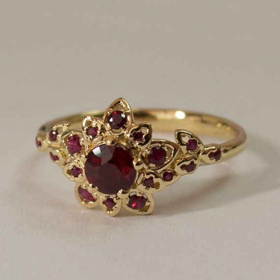 c29db7046238d1 A handmade 14k yellow gold ring showing a delicate flower set with  beautiful natural rubies of high quality. This ring in the pictures is set  with a 4.5mm ...