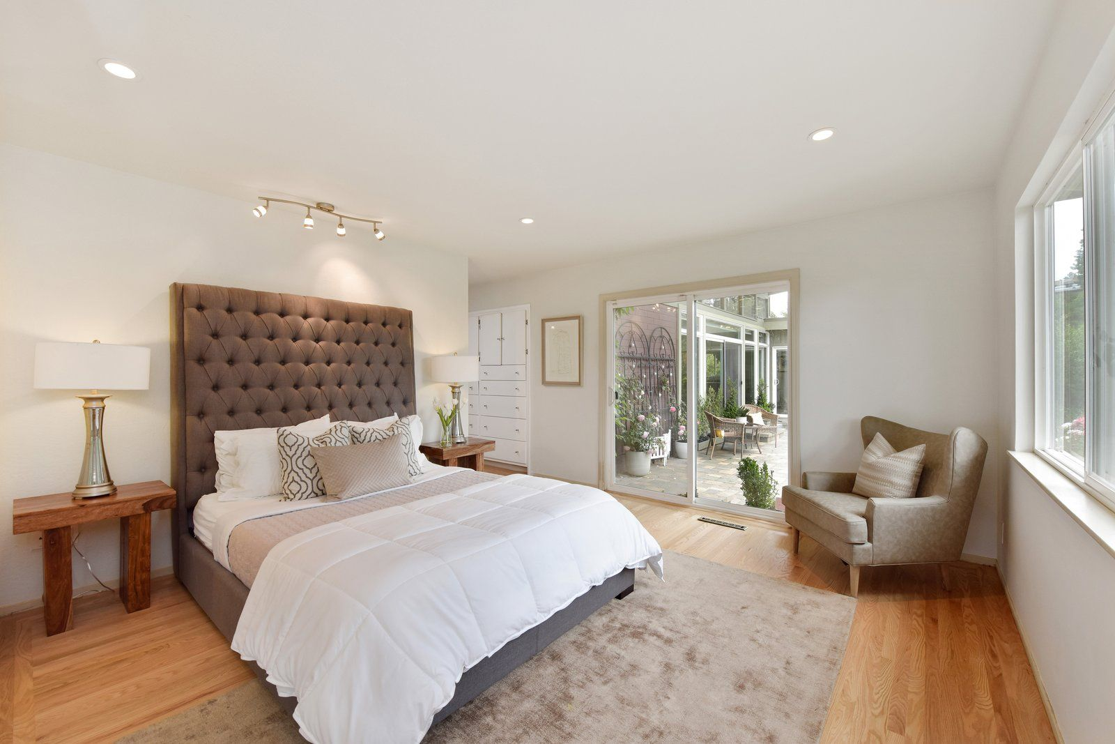 Master bedroom hardwood floors  Photo  of  in Grab This Updated Midcentury Home in Oakland For