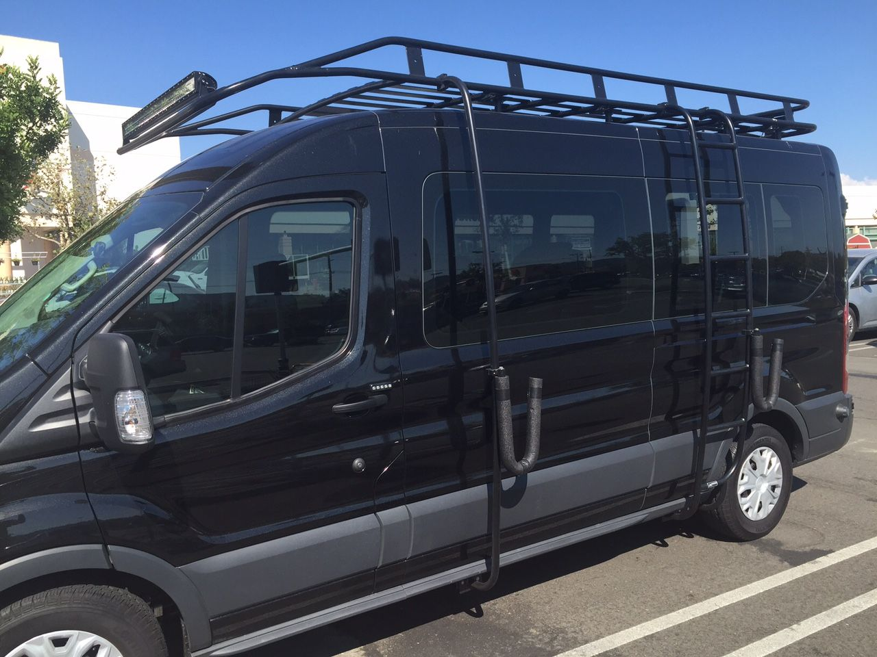 Aluminess roof rack ladder and surfboard hooks installed on a new ford transit