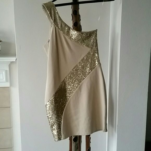 Bodycon party dress from Josh Brody It is tan with gold sequins. It is tight fitting off one shoulder dress. Never worn. It is thicker so it's a tad bit more forgiving Josh Brody Dresses One Shoulder