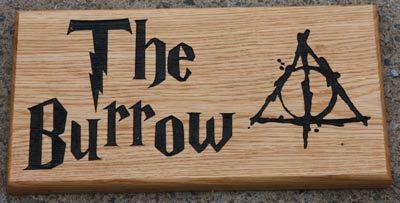 Wooden sign using customer artwork. Font Harry Potter. Size 373 x 200mm. ref - 1305.LW.111 www.sign-maker.net/wooden/oak-carved-signs.html