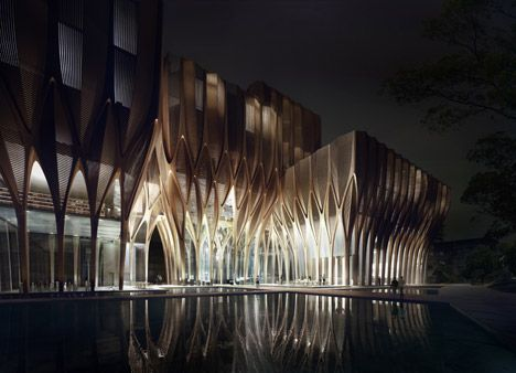 Zaha Hadid has unveiled designs for a new Cambodian institution made up of five interwoven wooden towers to house an archive of genocide-related documents.