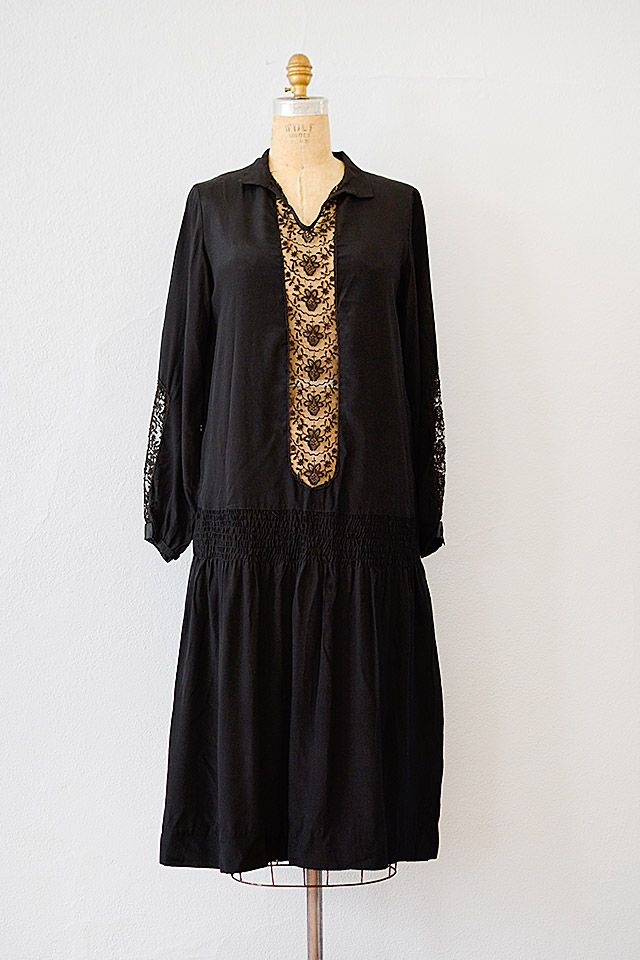 c8faffe387e4 1920 s black silk crepe dress features drop waist with smocked gathers on  the sides. V-neck has small collar and bodice features sheer lace panel on  front.