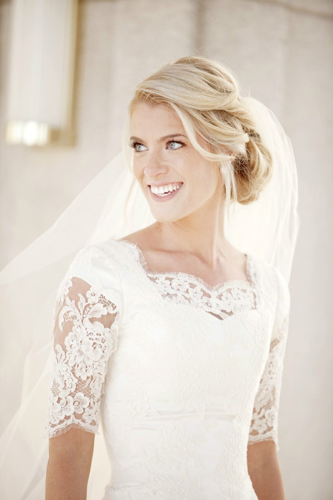 alta moda bride kate in a modest lace wedding dress with elbow sleeves image by