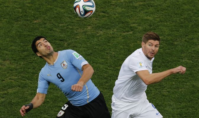 Uruguay\'s Suarez and England's Gerrard fight for the ball during their 2014 World Cup Group D soccer match at the Corinthians arena in Sao ...
