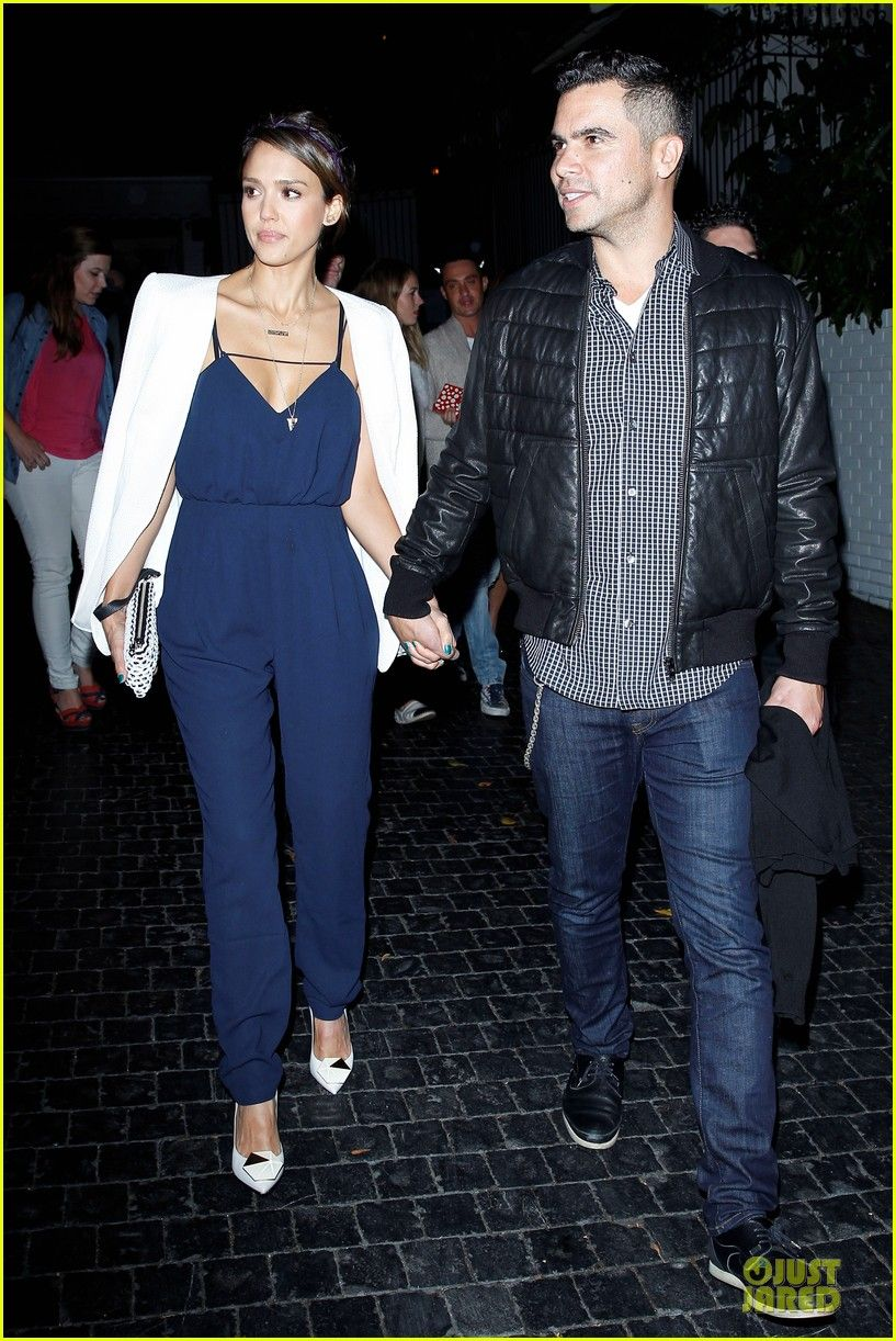 af3179e94bd Jessica Alba in a navy blue jumpsuit with a white blazer
