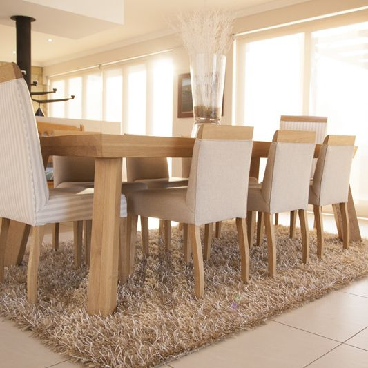Our Mukwa Dining Table And A Set Of Upholstery III Chairs High Low Back