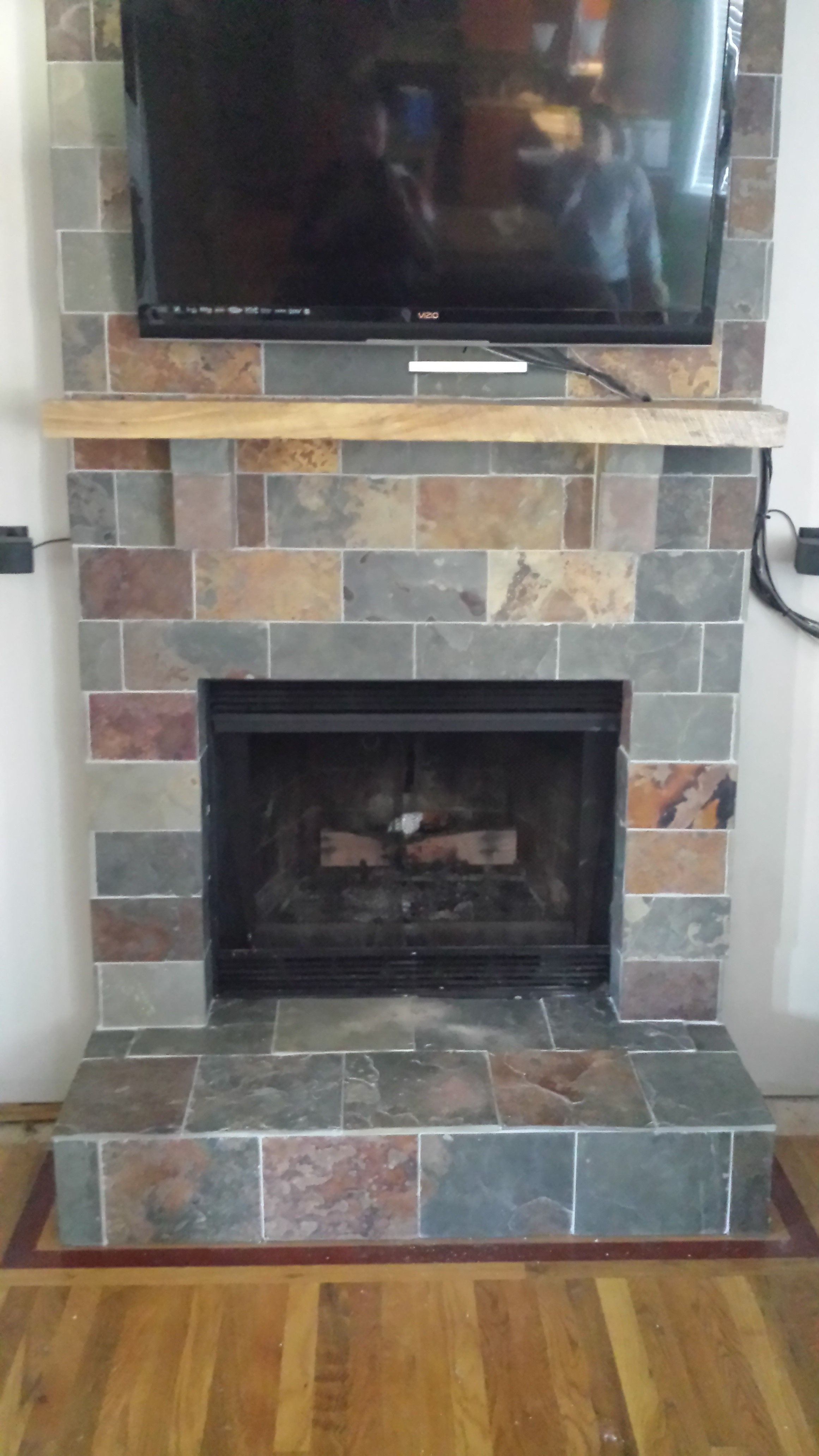 fireplace slate. Converted an old brick fireplace to a new slate tile