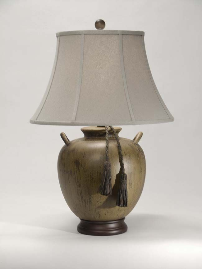 Rum Run Table Lamp Western Lamps - A braided leather tassel decorates the lamp base. Due to the nature of the special glaze, the color of each lamp will vary. From one of our superior quality collections and made in the USA.