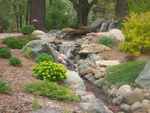 This Would Be A Beautiful Way To Landscape The Culvert Stone Landscaping Landscaping On A Hill Water Features In The Garden