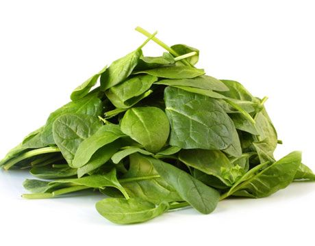 """Spinach. """"This leafy green, along with kale, is rich in antioxidants lutein and zeaxanthin, which keep eyesight sharp. It's also full of vitamin A and calcium punch, with 245 milligrams in a cup of the cooked stuff, almost as much as a glass of milk. A half-cup of cooked, fresh spinach also contains 3.2 milligrams of iron. (Keep in mind, however, that non-heme sources of iron don't absorb as easily, so eat your spinach with some vitamin-C-rich foods to make them more bioavailable.)"""" HuffPost"""