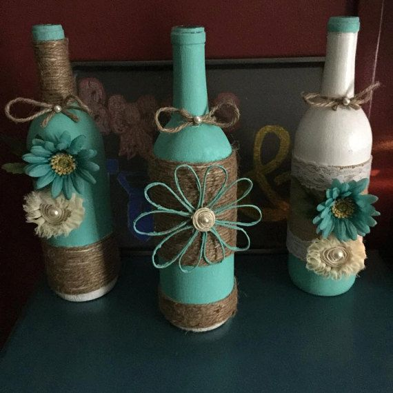 Decorated wine bottles table centerpiece by for Homemade wine bottle centerpieces