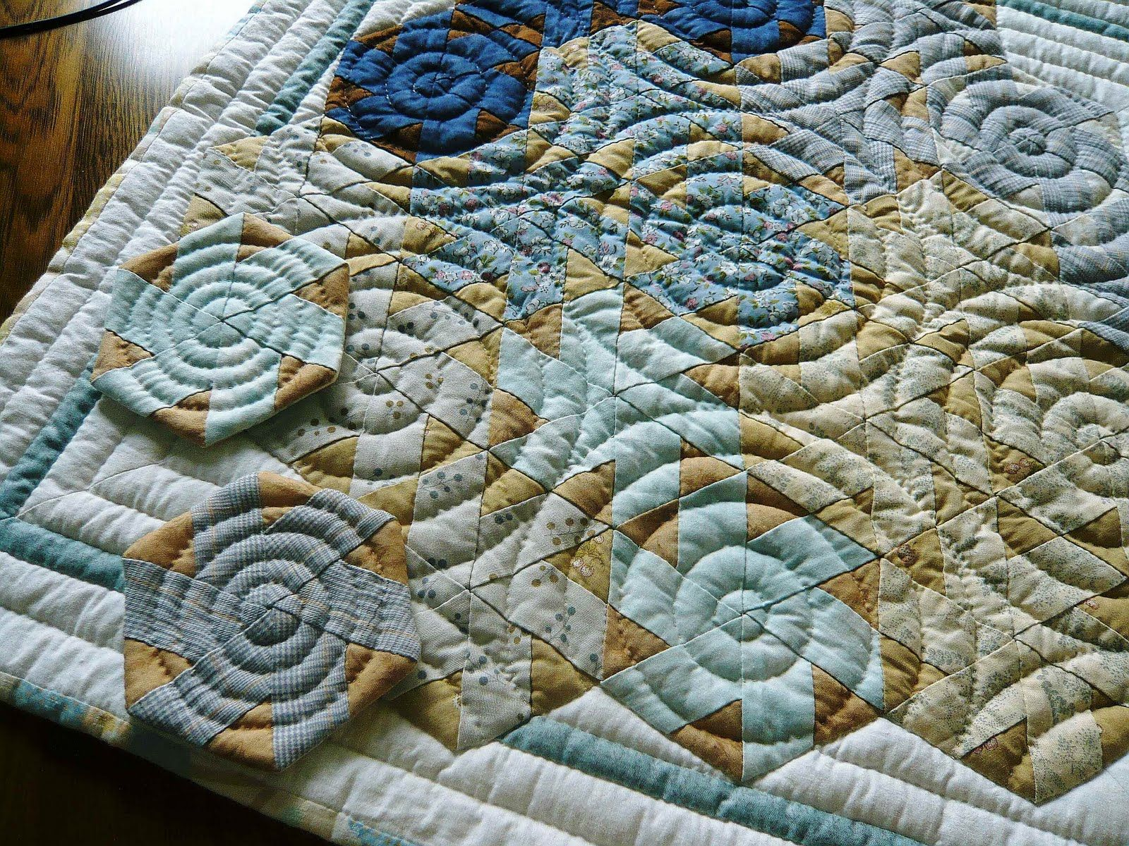 circular quilting pattern on angular patchwork - AWESOME
