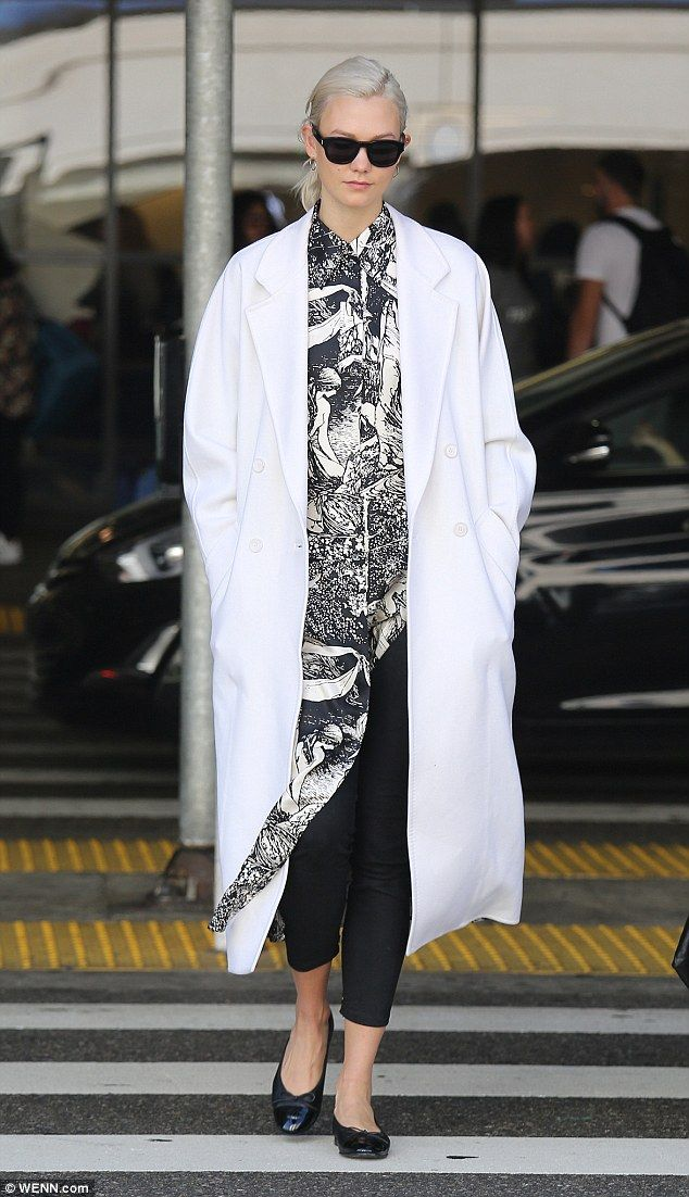 Monochrome! The 25-year-old supermodel looked elegant as ever in a sweeping white peacoat ...