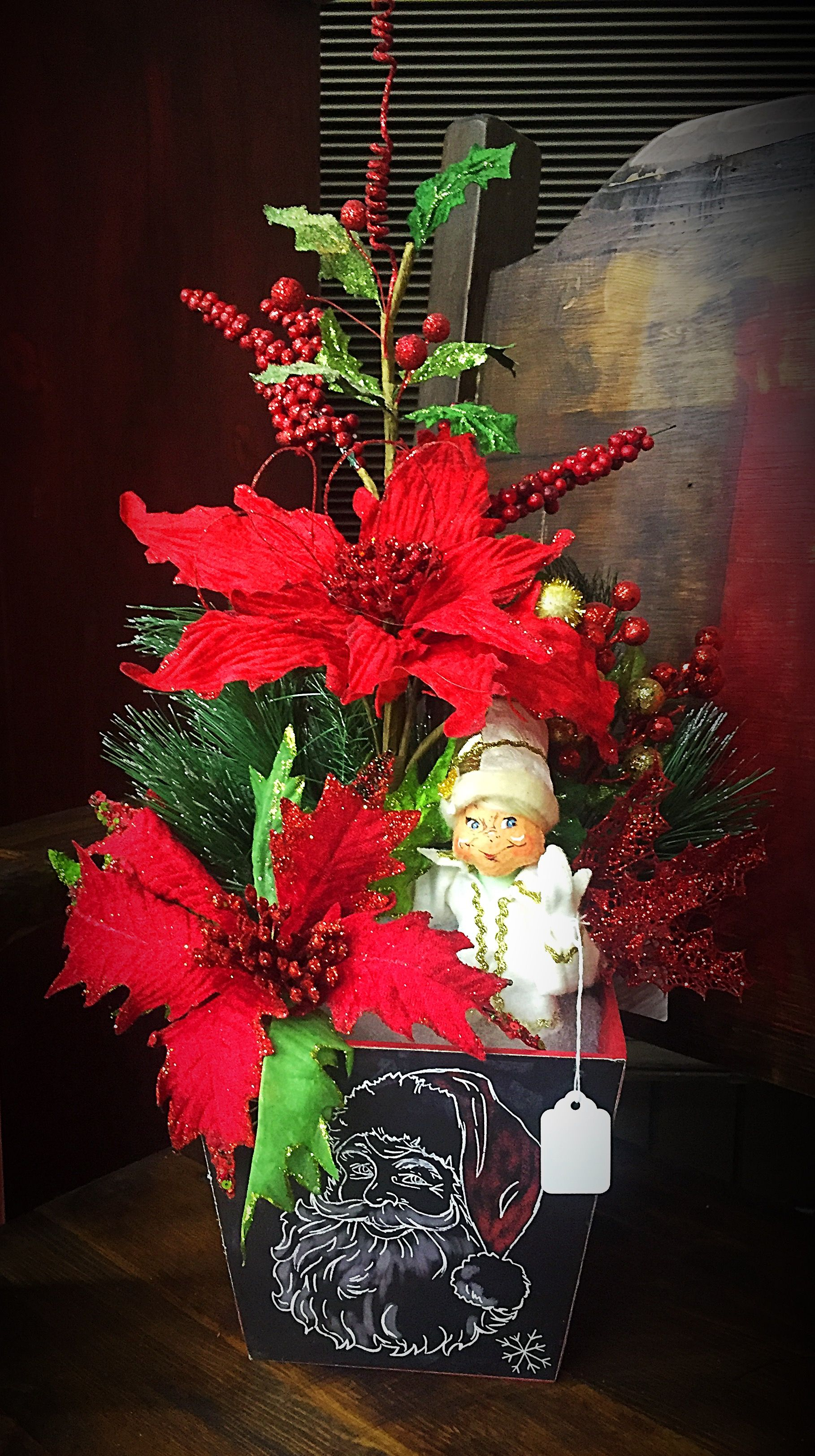 Christmas Elf and Red Poinsettia Floral Arrangement