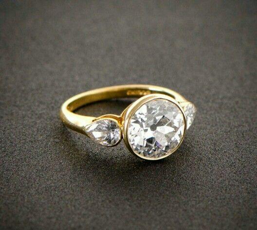 Yellow Gold Bezel Three Stone Engagement Ring Round
