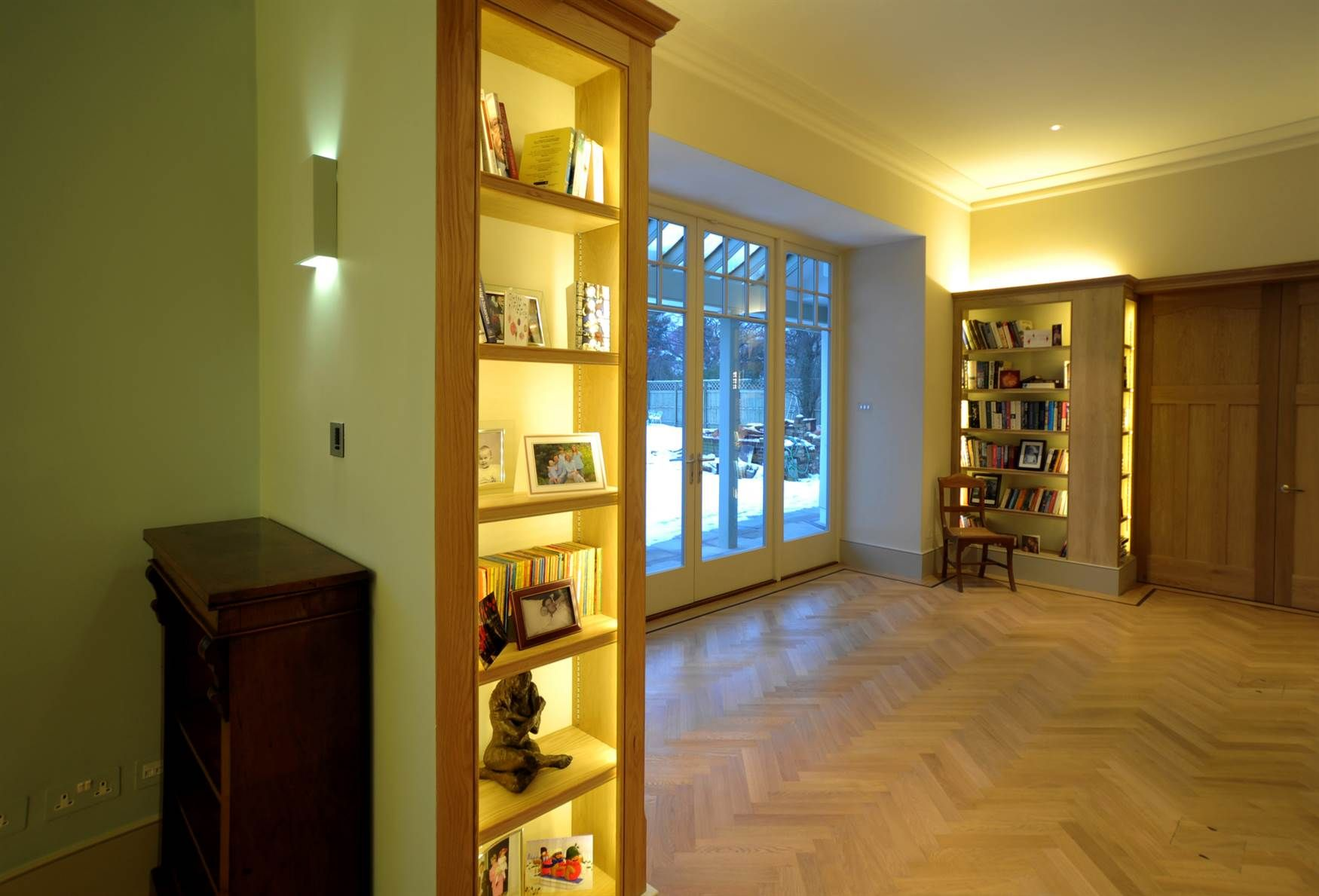 The Village LED tape in shelving and plaster wall light
