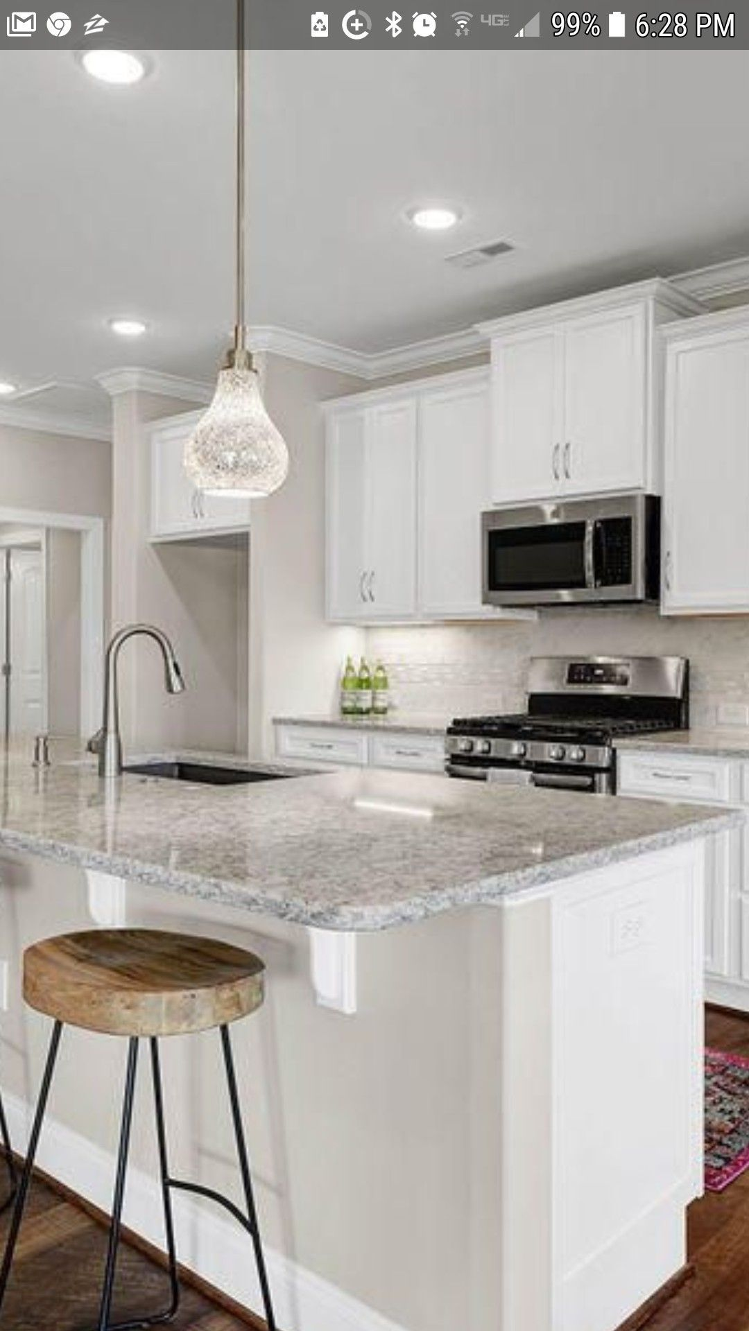 I like these creamy countertops with pure white cabinets kitchen