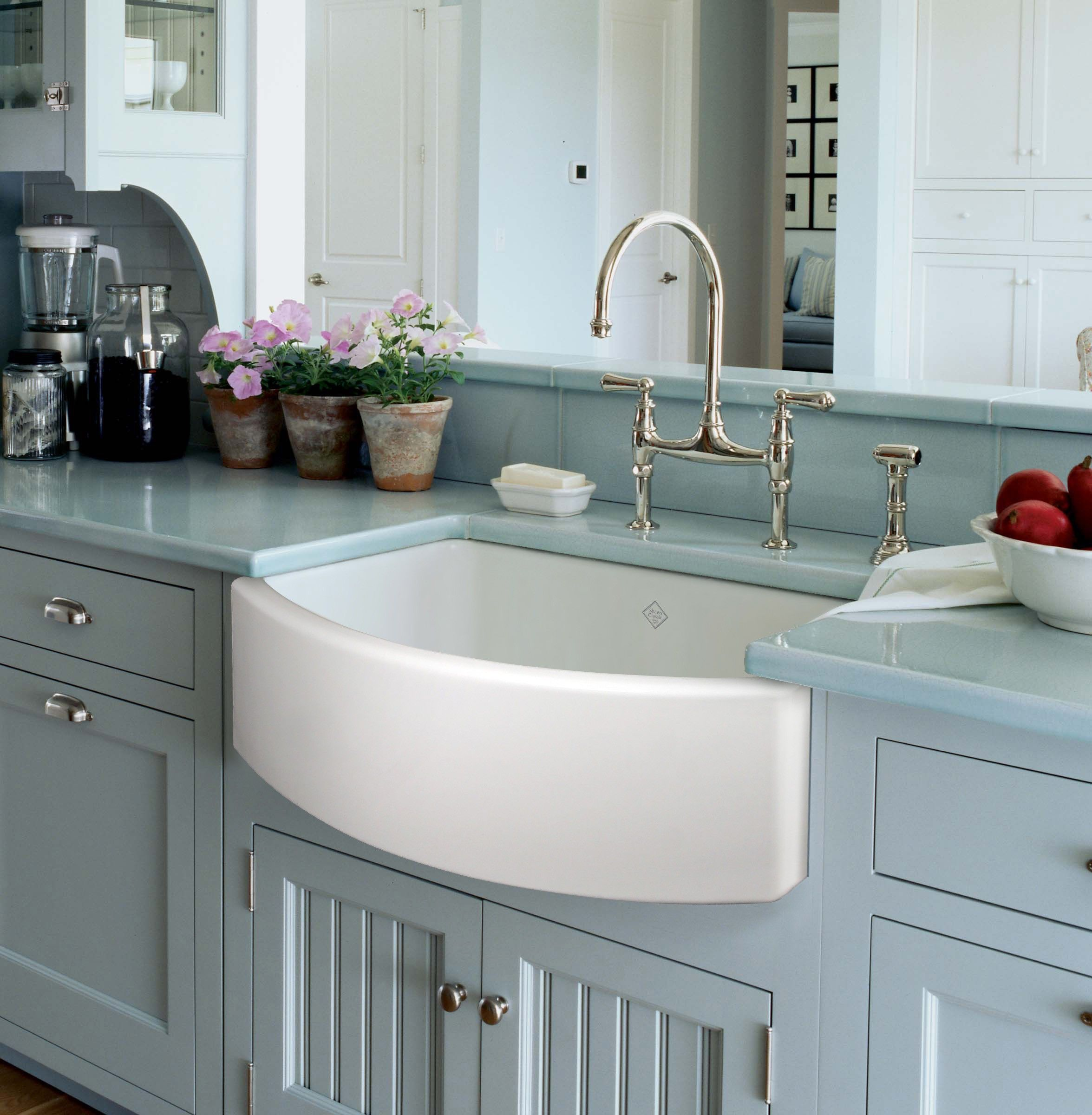Light Blue Wooden Kitchen Cabinet Decor With Curved White Tone Apron ...