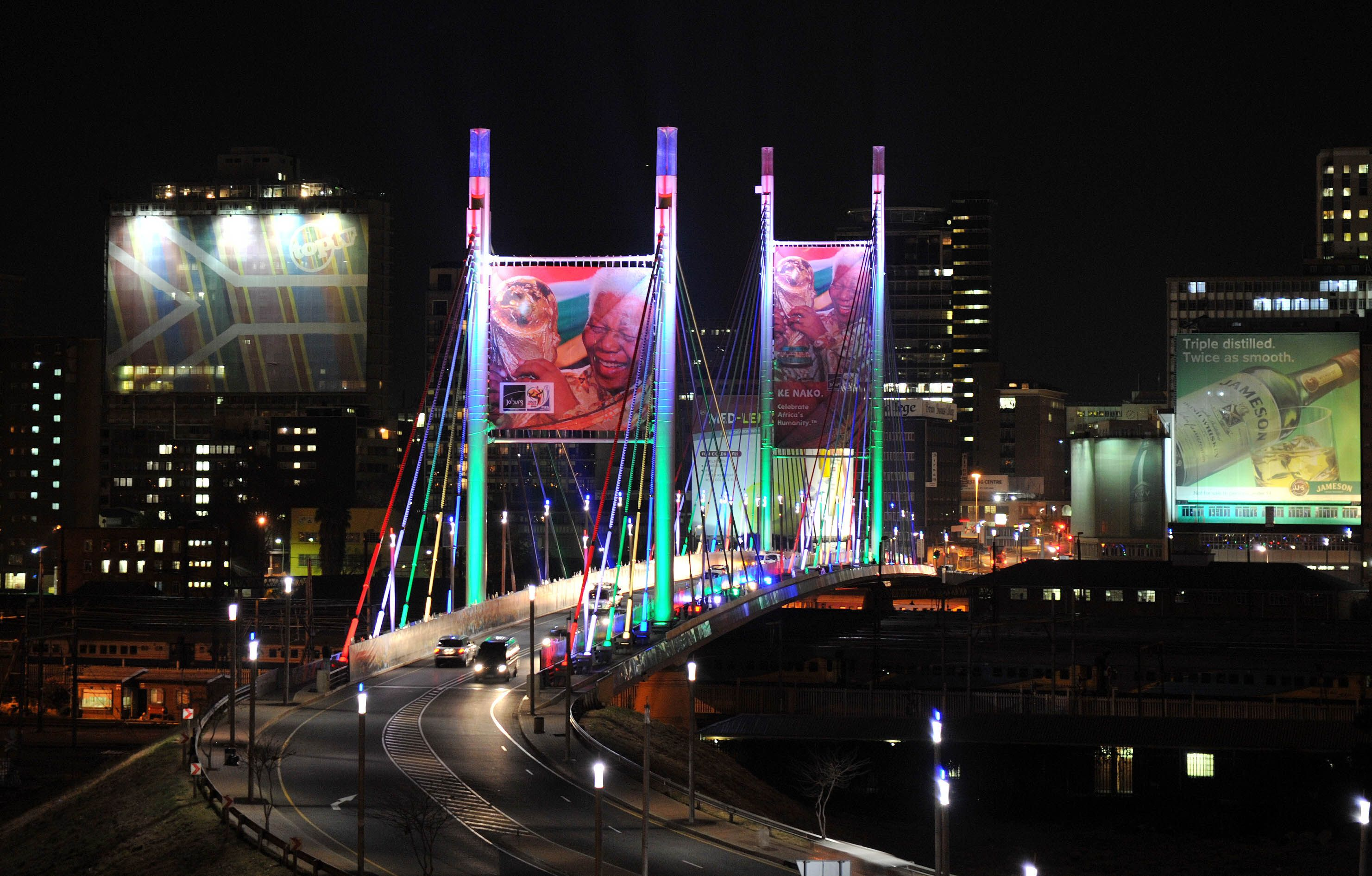 Nelson Mandela Bridge, Johannesburg, South Africa.  ColorReach Powercore fixtures transformed the bridge at night in a colorful, yet sustainable way.  To promote unity, cultural exchange and economic growth, the LED lighting solution brings together two disparate economic areas.