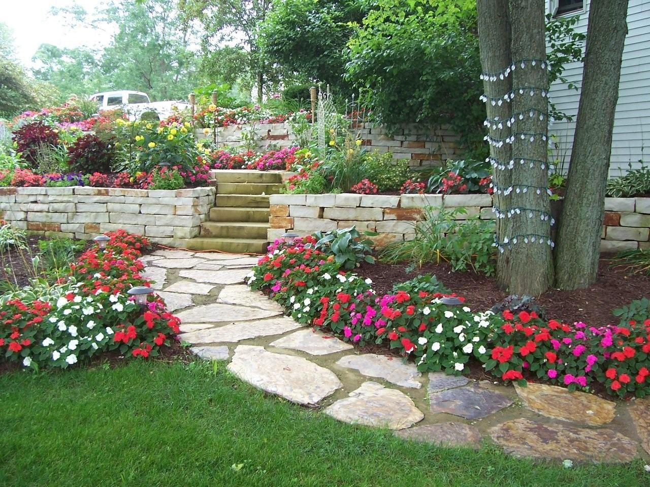 flagstone and steppers combine with thoughtful landscaping to