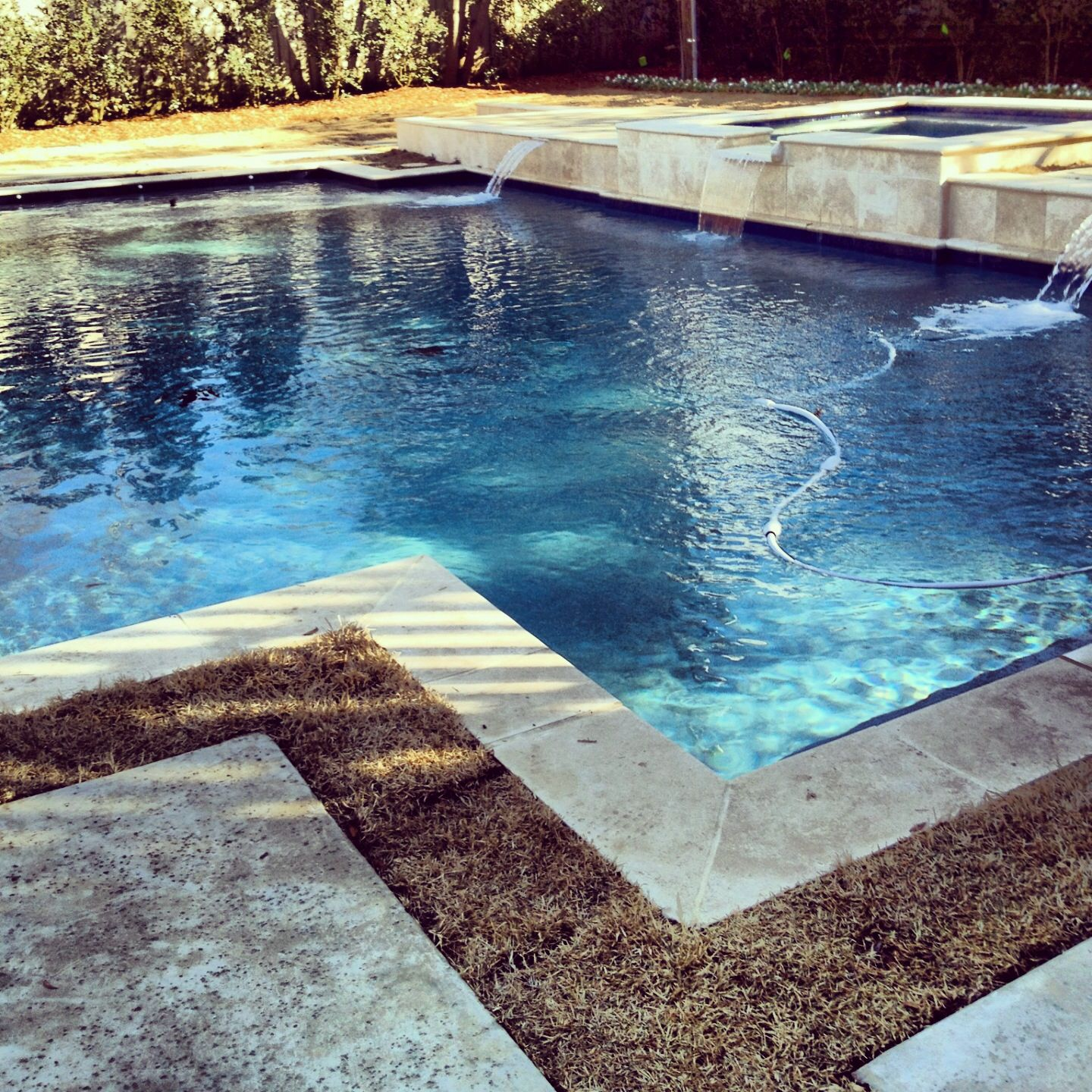 straightline pool and spa hottub with scupper