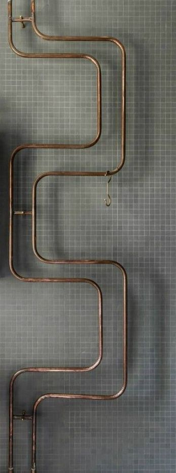 Exposed copper hot water pipe drying rack