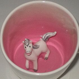 Totally need this. He would make me smile every time I sipped my tea! Unicorn Surprise Mug by SpademanPottery on Etsy, $29.00