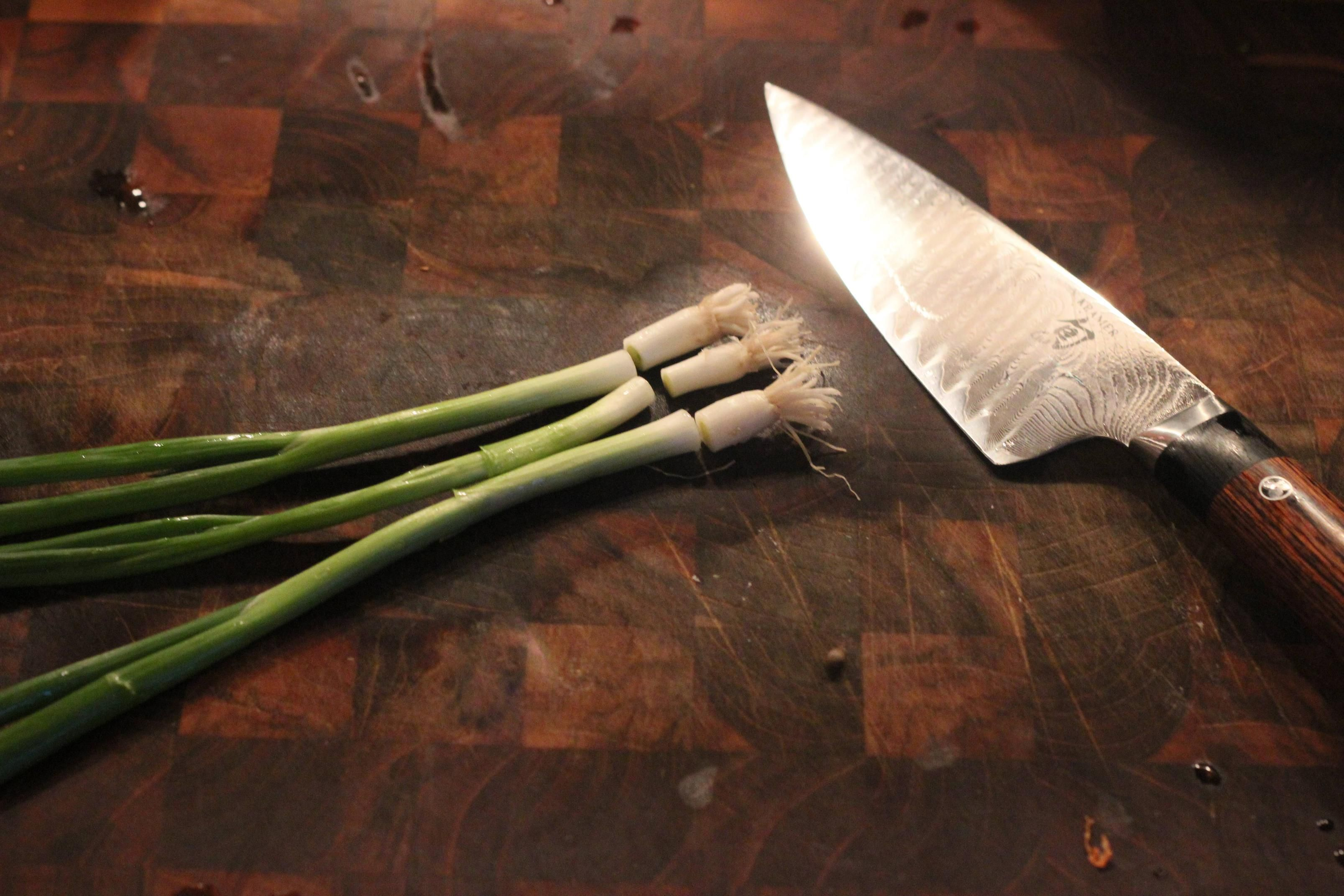 Don't throw away your scallion roots! You can regrow scallions in a few days.
