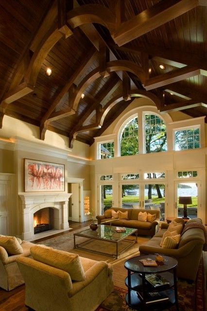 fabulous white living rooms vaulted ceilings beams | A fabulous living room features a vaulted ceiling of wood ...