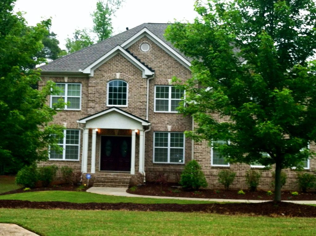 Traditional Home Brown Brick Exterior With Doors Painted Sherwin Williams Polished Mahogany