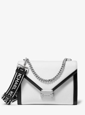 4dc3e741f81f A sport-luxe take on our Whitney shoulder bag, this version is updated in pebbled  leather with contrast trim and logo taping on the strap.