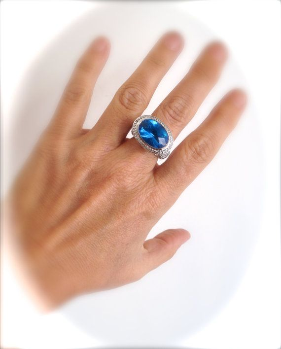 Stunning Piece Features a Gorgeous Blue Center Stone Nestled In a Glittering Pave Setting Just Beautiful From Every Angle   Would Pair