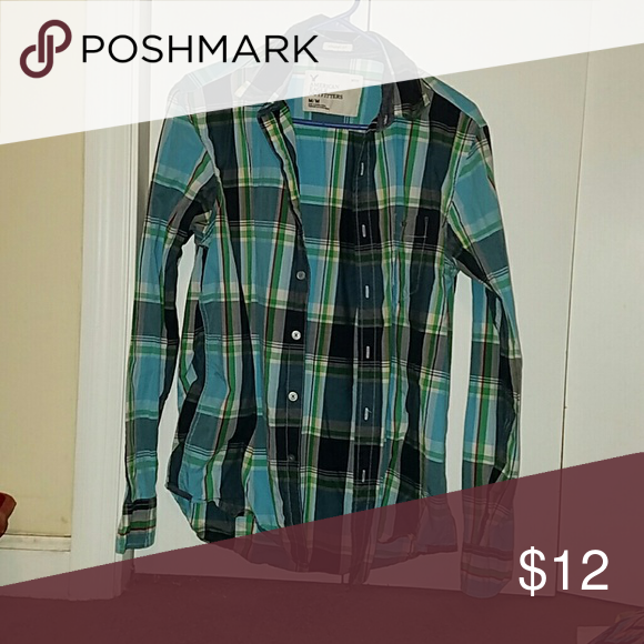 Plaid button down American Eagle plaid shirt. It is a men's but I know we women love wearing these shirts. American Eagle Outfitters Tops Button Down Shirts