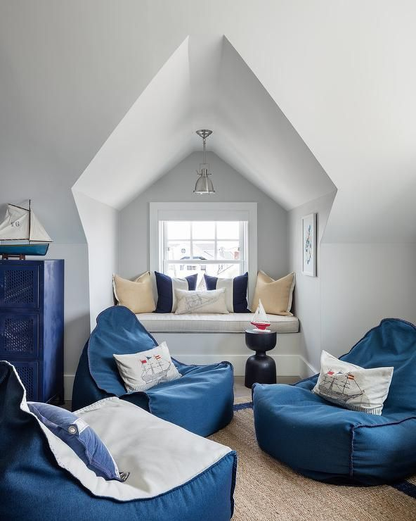Boys Room Featuring A Window Seat Alcove With Large Navy Blue