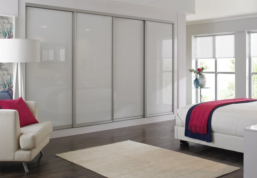 Sliding Wardrobes Are A Versatile Fitted Bedroom Design White Glass Bedroom Furn Wardrobe Design Bedroom Glass Bedroom Furniture Sliding Door Wardrobe Designs