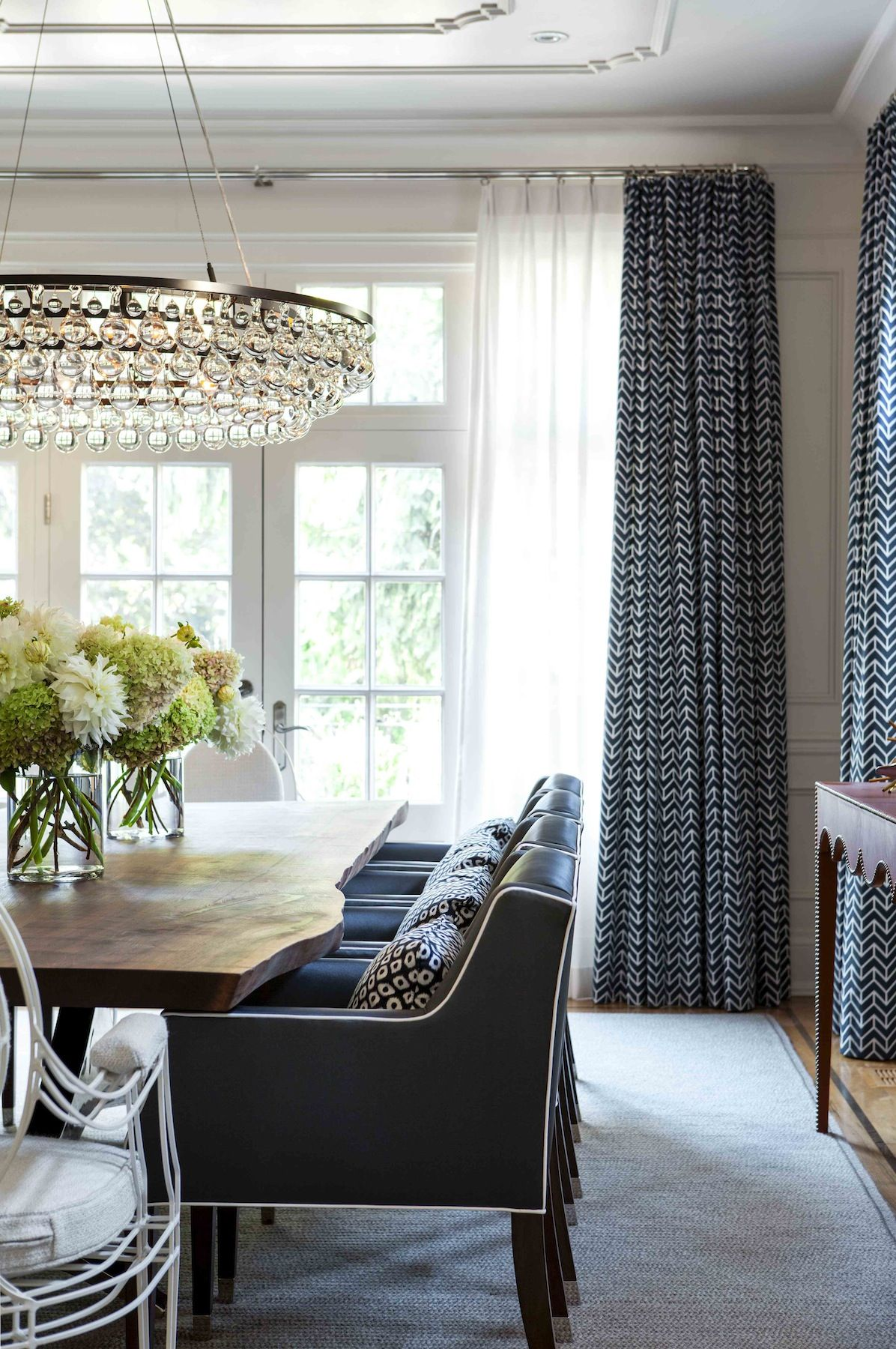 Glass chandelier in this navy dining room Jennifer Worts