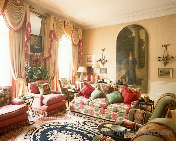 Nina Campbell A Large Scale Portrait Painting Hangs On The Wall Of This Elegant Living Room With Curtains Drape Rugs In Living Room Interior Interior Design