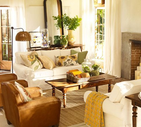 love the sunflower pillows, green urn, and candles in the fireplace