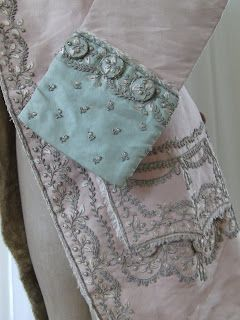 Court Coat, ca. 1765; pink silk with mint green cuffs (faded now); silk fur lining for warmth; silver leaf embroidery [3rd of four pins]