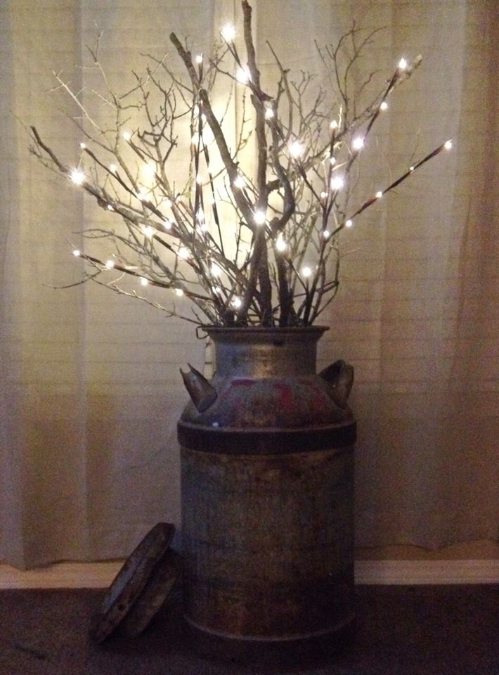 Led branch lights and a few real branches in an old milk