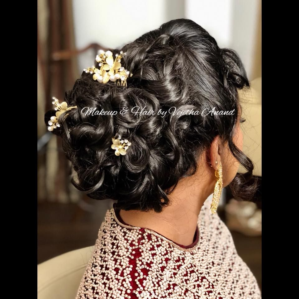 bridal hair at its best! indian bridal hairstyle by vejetha