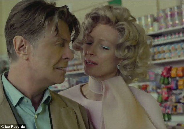 Wedded bliss: Swinton and Bowie portray a happily married couple whose world is torn apart by the notion of celebrity