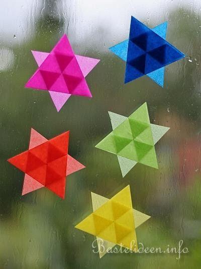 Weihnachtsbasteln mit Papier Transparente Mini Sterne Fensterbild Adventskerzen Bastelideen mit Bastelvorlagen Fensterbilder Basteln 4 E...
