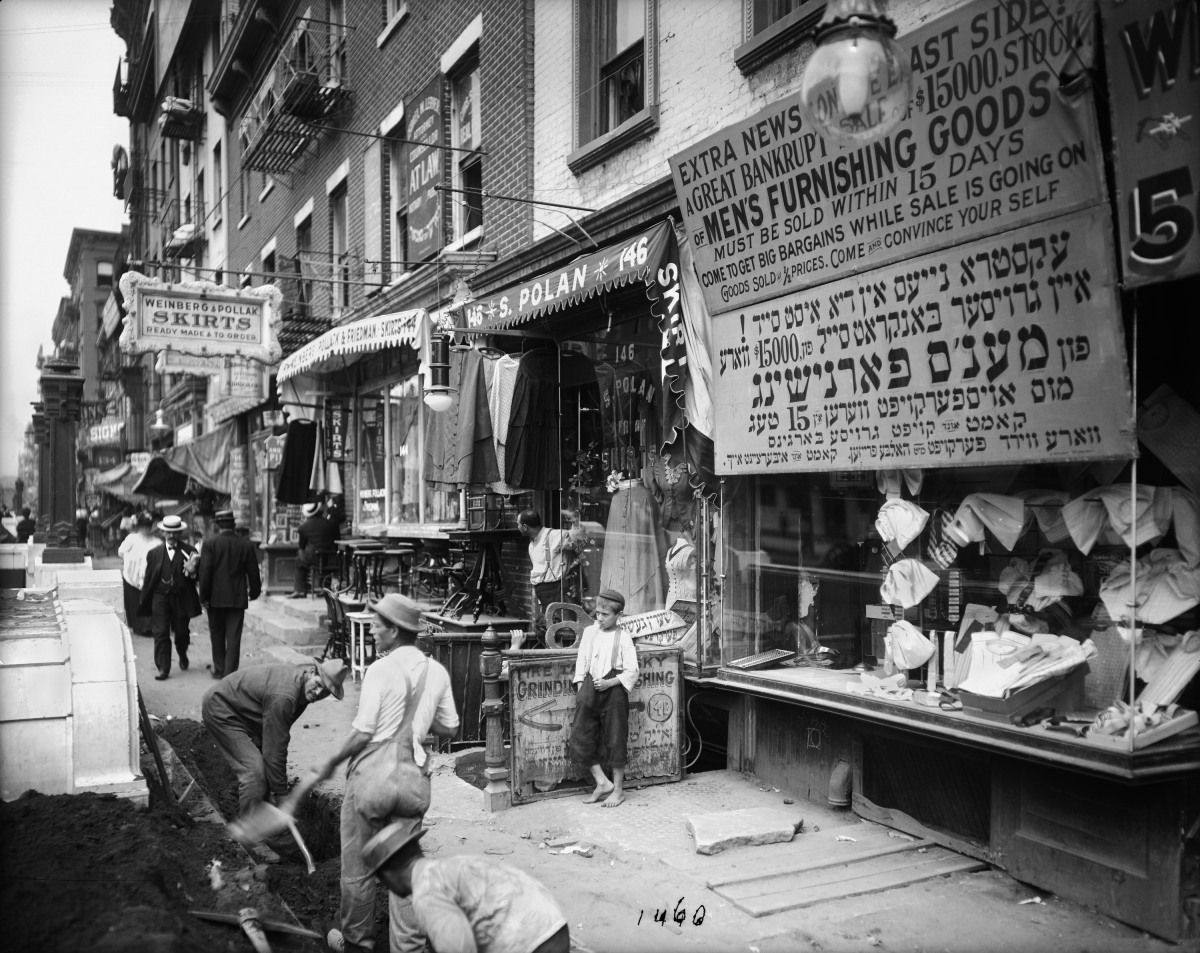 July 29, 1908 photo provided by the New York City Municipal Archives, workers dig in the street along the sidewalk on the north side of Delancey Street in New York. New York City Photo Database: Department Of Records Releases 870,000 Images Online (PHOTOS)