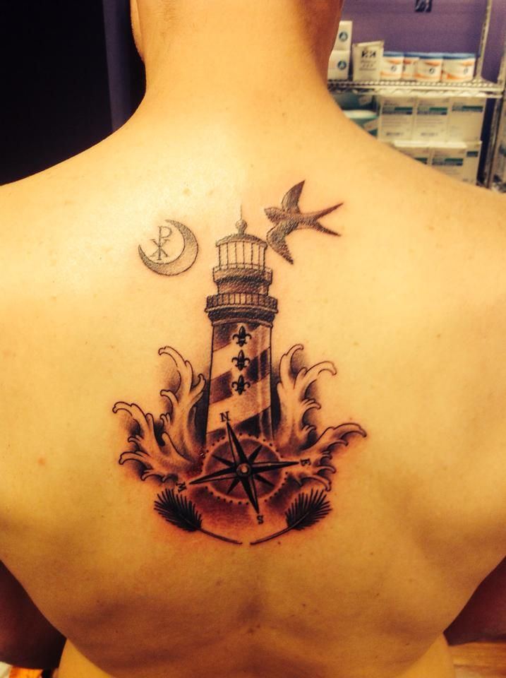 A variation of the modern Quate family crest # tattoo # lighthouse # compass