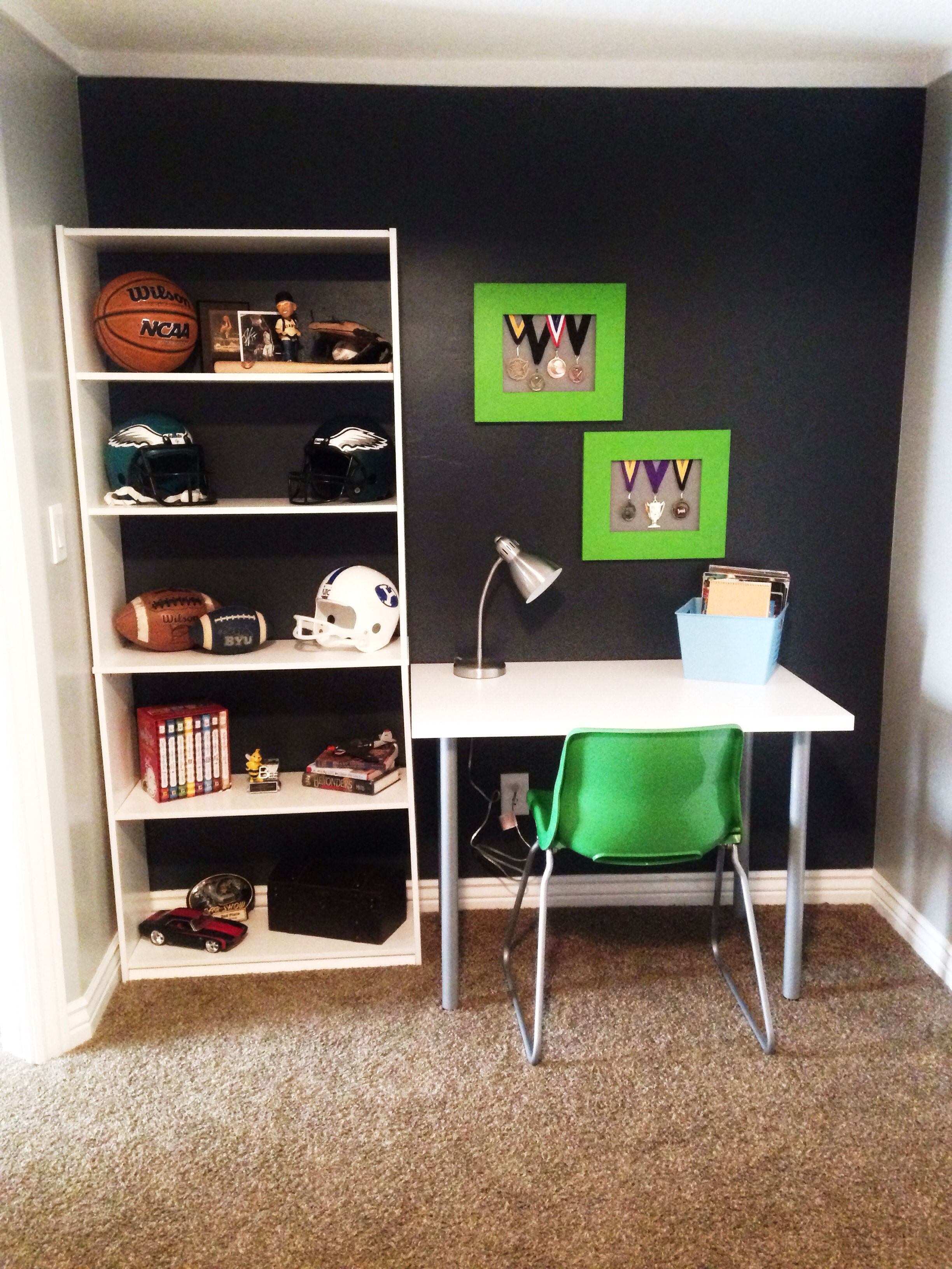 Boys bedroom medal display desk area black accent wall