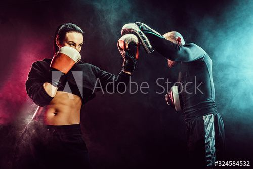 Woman exercising with trainer at boxing and self defense lesson, studio, smoke on background. , #Sponsored, #trainer, #boxing, #Woman, #exercising, #defense #Ad