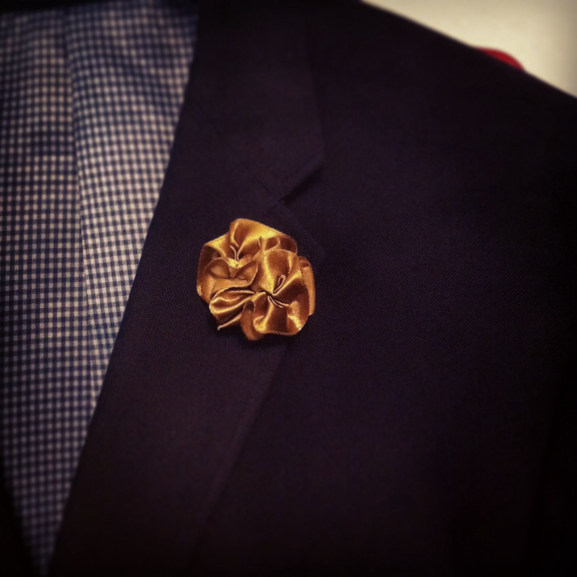 DIY Lapel Flower - satin ribbon fashioned in the shape of a
